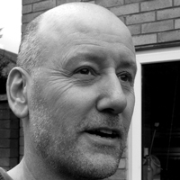 a black and white portrait of author Geoff Hall